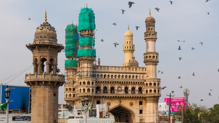 monument in india: Hyderabad, Telangana, India, 28th Feb 2016: Famous charminar monument in hyderabad covered with nets as part of the repair and restoration process
