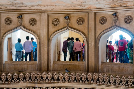 second floor: Hyderabad, Telangana, India, 28th Feb 2016: Interior arches of the second floor in the charminar Hyderabad showing people visiting
