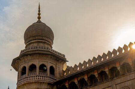 hyderabad: Minar tower of a mosque during sunset against clouds. Shot in the old city of hyderabad