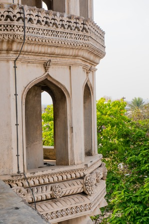 hyderabad: architecuture details of the towers of charminar hyderabad with trees in the background