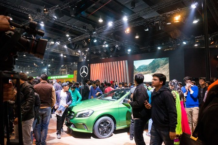 mercedes: DELHI, INDIA 6TH FEB 2016: Visitors looking at the cars at the mercedes benz stall at the auto expo 2016 Editorial