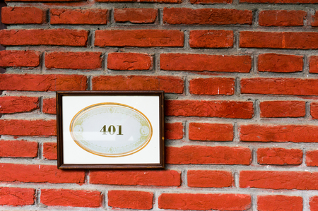 number plate: Framed number plate with 401 written on it, mounted on a brick wall. A great reference to the 401k retirement fund or unauthrized access in HTTP