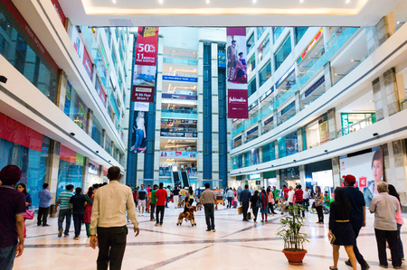 gurgaon: DELHI, INDIA, 22ND OCTOBER 2016 - People roaming around in a shopping mall in Delhi Gurgaon India. airconditioned malls have become a great hangout in the delhi summer heat