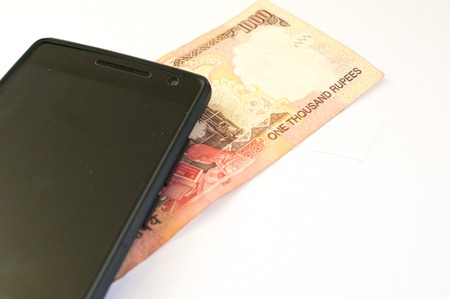 denoting: Mobile phone with indian currency set on a white background. Denoting payment through mobile and mobile wallets