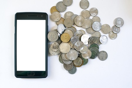 unified: Mobile phone with indian currency set on a white background. Denoting payment through mobile and mobile wallets. Pile of old and new coins with phone