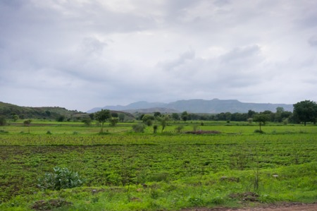 monsoon clouds: Monsoon clouds over farms and fields in India. Monsoon is the most important season for agriculture Stock Photo
