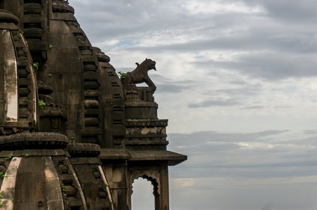 indore: Stone lion sitting atop the arches of a temple entrance in Maheshwar, India. These intrecate carvings are being preserved as part of history