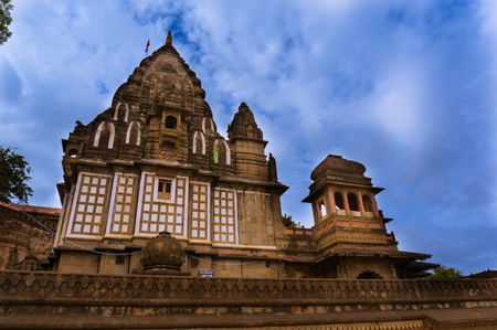 indore: Ahilya temple in Maheshwar, Madhya pradesh set againt the impressive monsoon clouds. This famous landmark is a popular tourist destination