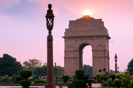 skyscapes: India gate in Delhi shot at dusk with the sun overhead and with a beautiful sky Stock Photo