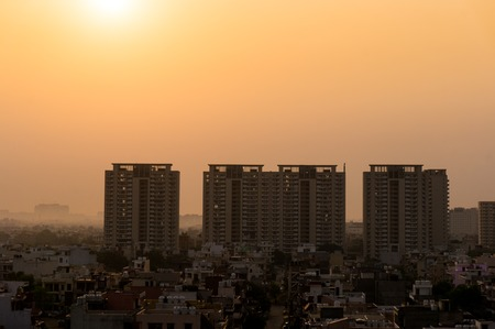 gurgaon: Dawn over gurgaon delhi showing the buildings in various stages of construction. The development of the city has led to a boom in infrastructure projects Stock Photo