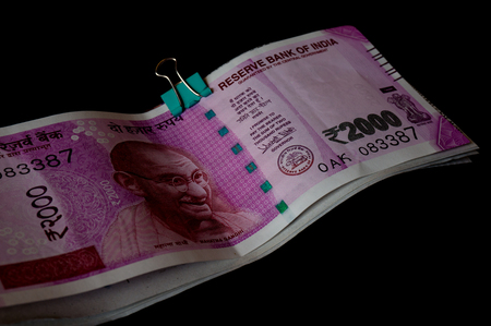 introduced: The new rupee 2000 currency notes introduced in india to curb black money. Isolated on black Stock Photo
