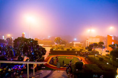 Delhi, India - 6th Nov 2016: Foggy smog filled evening at Select citywalk shopping mall in Delhi. This popular hangout place was empty owing to the dense pollution Editorial
