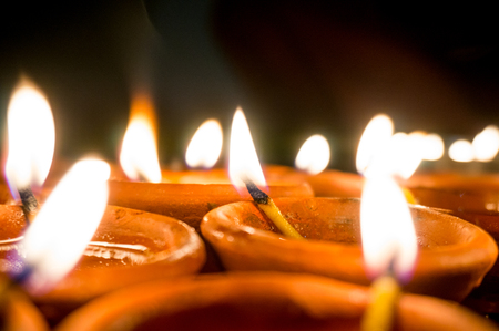 diyas: Shots of earthenware lamps filled with oil and with a cotton wick. These diyas are lit during diwali and other celebrations Stock Photo