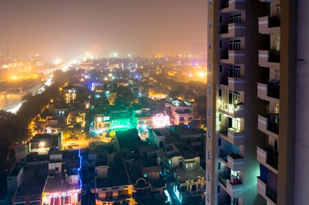 gurgaon: Noida delhi india city scape with lights in all houses on the eve of diwali. Indians usually celebrate the hindu festival of diwali by putting colorful lights Stock Photo