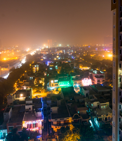 Noida delhi india city scape with lights in all houses on the eve of diwali. Indians usually celebrate the hindu festival of diwali by putting colorful lights Stock Photo