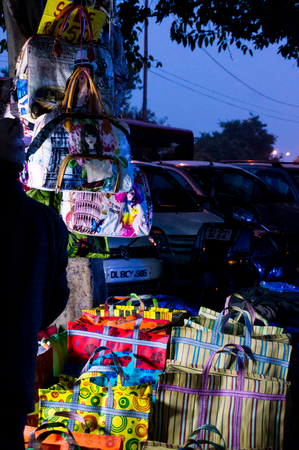 Delhi, India - 28th Jan 2017: Street market in Chandni Chowk near red fort at night selling ladies bags or purses. LED lit open shops are perfect for getting cheap items
