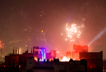 Buildings silhouetted against fireworks in Jaipur during the festival of Makar Sankranti. Even Diwali sees a similar firework display Stock Photo - 73475909