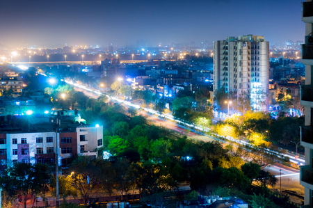 Noida cityscape at night showing lights, buildings and residences. Shows the urbanization and development of Delhi
