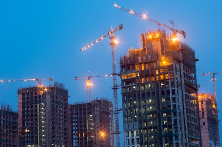 Construction work on building at night Stock Photo