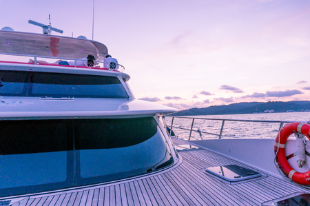 Deck of a luxury yacht shot during the purple light of dusk Banco de Imagens