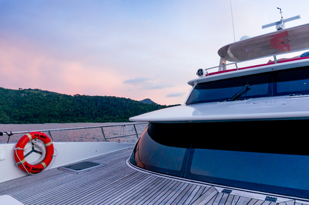 Deck of a luxury yacht shot during the purple light of dusk Editorial