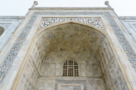 Beautiful marble arch with windows at the Taj Mahal