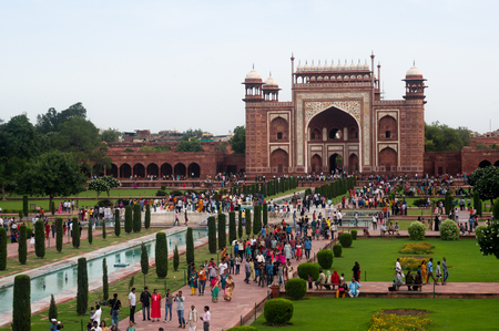 Arched entry gate for Taj Mahal with huge crowd of people Editorial