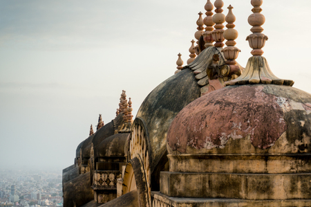 domes and spires of a hindu temple with jaipur city visible in t