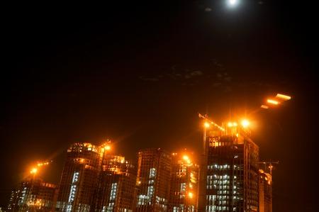 Gurgaon Noida sky scraper under construction at night Stock Photo