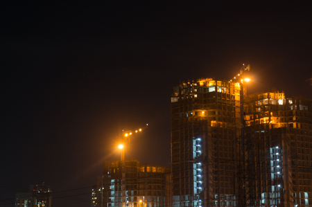 Gurgaon Noida sky scraper under construction at night Stock Photo
