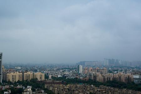 Noida Skyscraper under construction with smaller buildings aroun
