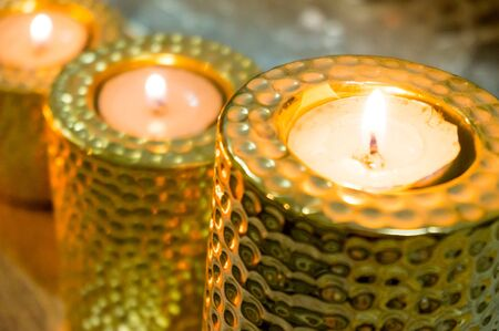 Golden candle holders with tea lights