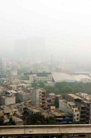Smog fog covered noida cityscape at dawn