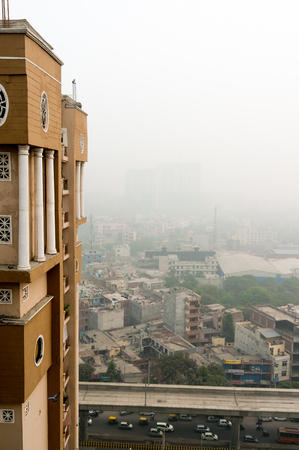Vertical shot with buildings and smog in Noida Delhi Stock Photo