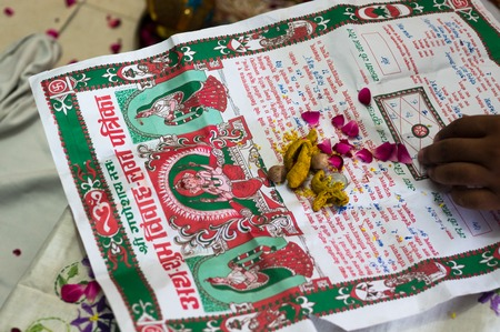Lagan Patrika, an invitation to hindu gods and goddesses on the occassion of a marriage. Littered with flower petals and raisins as offerings