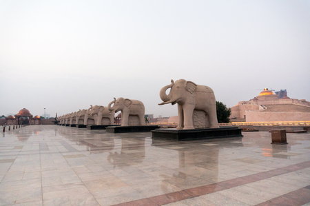 Statues of elephants placed in a straight line in the famous landmark Ambedkar Park of Lucknow. The red sandstone work and beautiful reflective floor add to the beauty