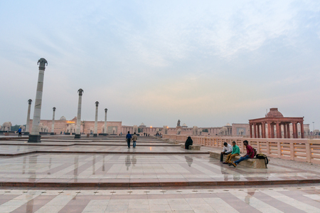 Lucknow, India - 16th Nov 2017: People sitting and enjoying at dusk in the middle of the pillars, reflective floor and various mughal architecture decorations