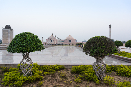 Beautiful artistic plants with the museum of Ambedkar park in teh background. The beutiful gardens of this landmark make it a popular hangout spot