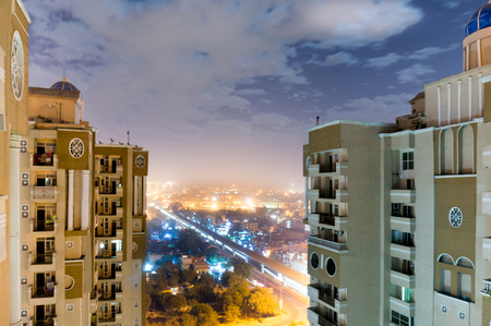 Skyscapers with the noida cityscape showing between them