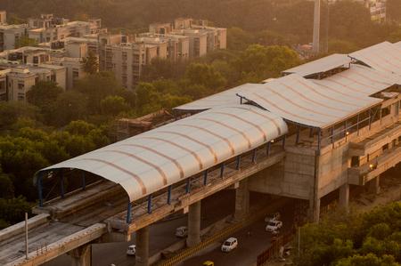 Under construction metro station shot at dusk in Noida Stock Photo
