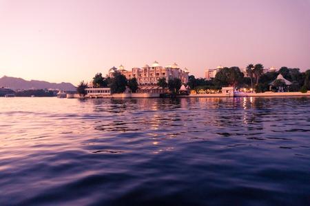 Hotels on the banks of lake pichola udaipur at dusk