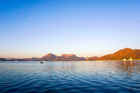 Serene dawn shot of lake with mountains in the distance