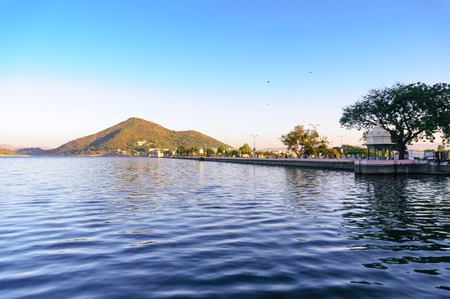morning shot of Fateh sagar lake with blue water and hills in th Stock Photo
