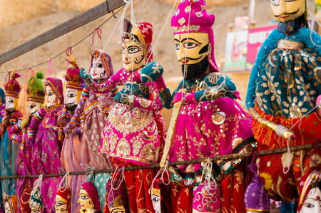 Traditional Rajasthani indian puppets handing from a wall
