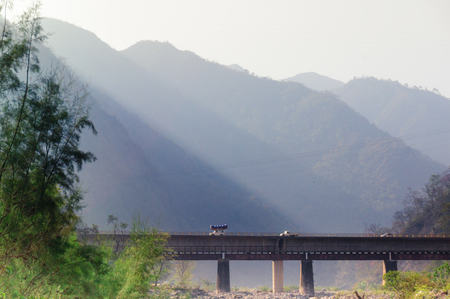 Shot of light coming off the himalaya mountains with a bridge in