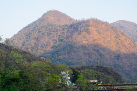 mountains and trees with buildings at haridwar shivpuri Stock Photo