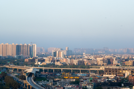 Noida Delhi cityscape with buildings and metro station