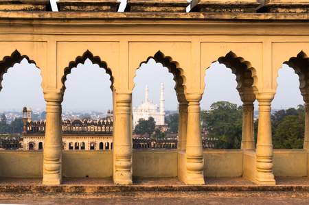 Mosque seen through the arches of the bara imambara in lucknow Stock Photo