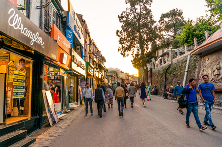 People roaming past branded showrooms on mall road Shimla