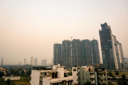 Under construction skyscraper shot at dusk in noida gurgaon Stock Photo